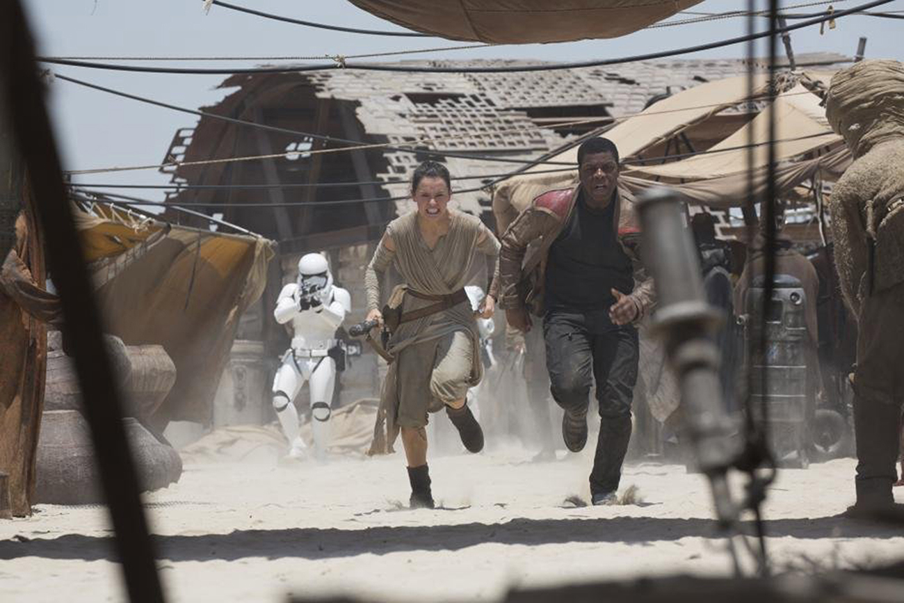 "Daisy Ridley and John Boyega in ""Star Wars: The Force Awakens."" (Photo courtesy Lucasfilm/TNS)"